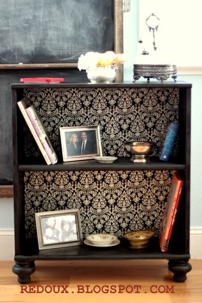 Turn that old bookcase into something cute with scrapbook paper or wallpaper.