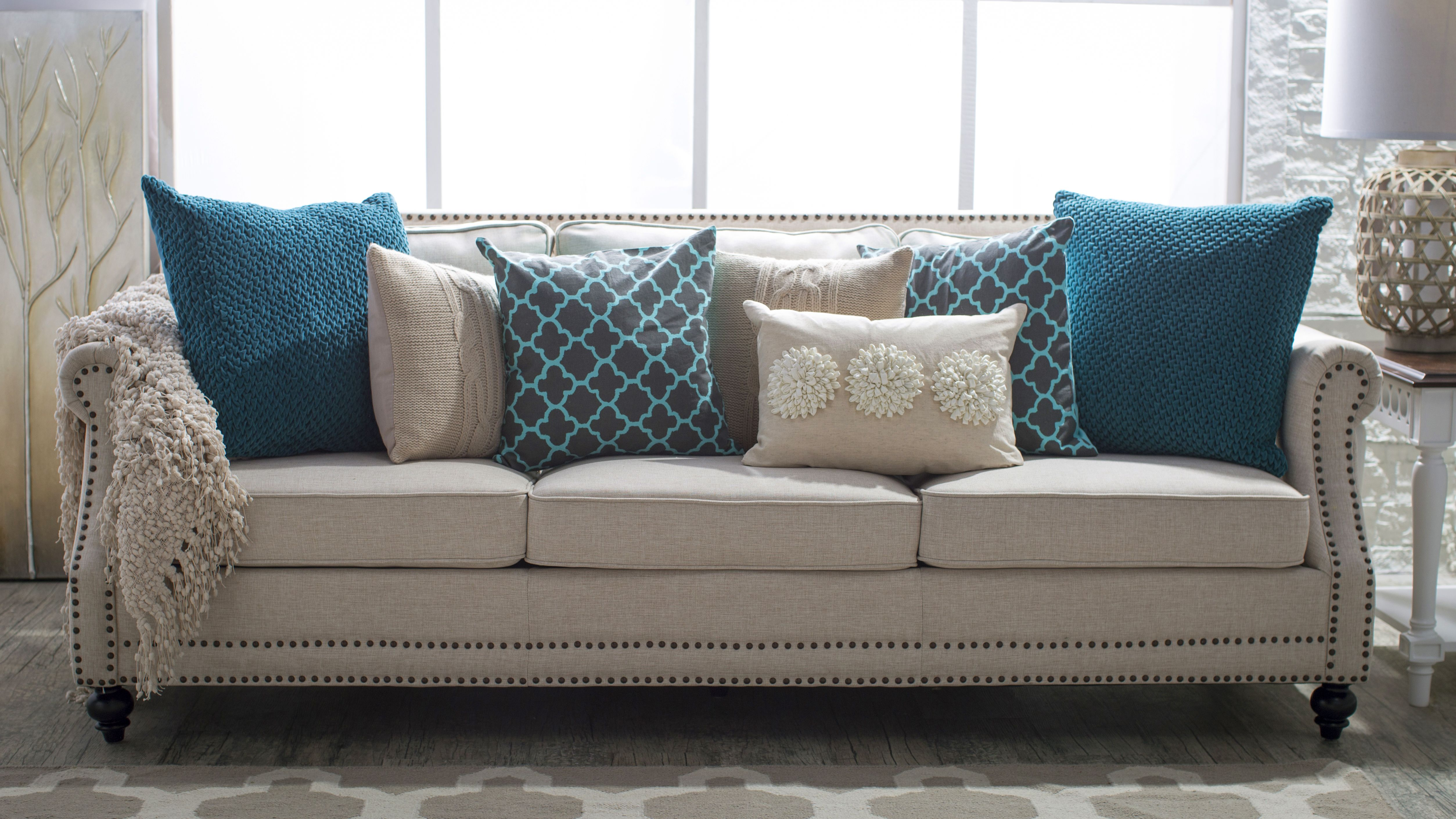neutral sofa with throw pillows