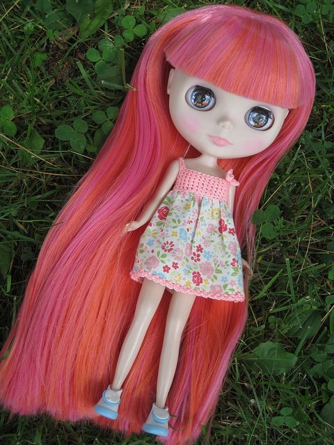 My first reroot, on a Blythe of course! Sadly i have NO idea what doll this was!! She was in pieces, a sad product of some early tries at customizing. Too often people get Blythes and try to customize them right away. They often end up unfortunate looking, to say the least. Anway with this girl I only did her hair, spray matted her, and changed her eyechips. I think she is marvelous now ^^
