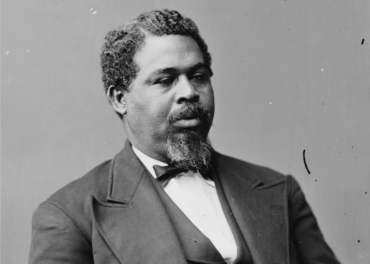 """Robert Smalls was a former slave.He stole a confederate South Carolinian ship called """"The Planter"""" and sailed to freedom with other slaves including his wife and children."""