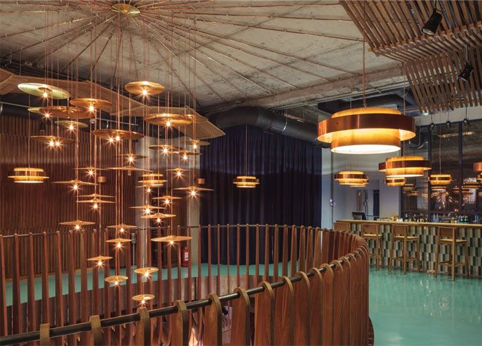 club recalling a '60 s audition hall interior decor hermes club
