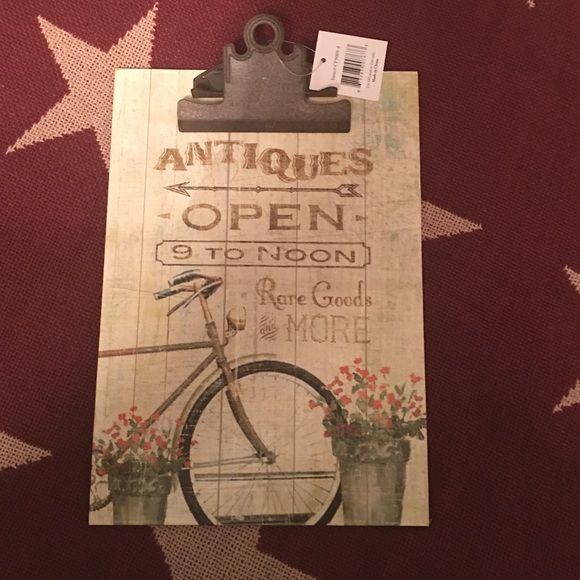 Clipboard and paper. Cute clipboard with flower pots and bicycle. Paper included. The Hearthside Collection Other