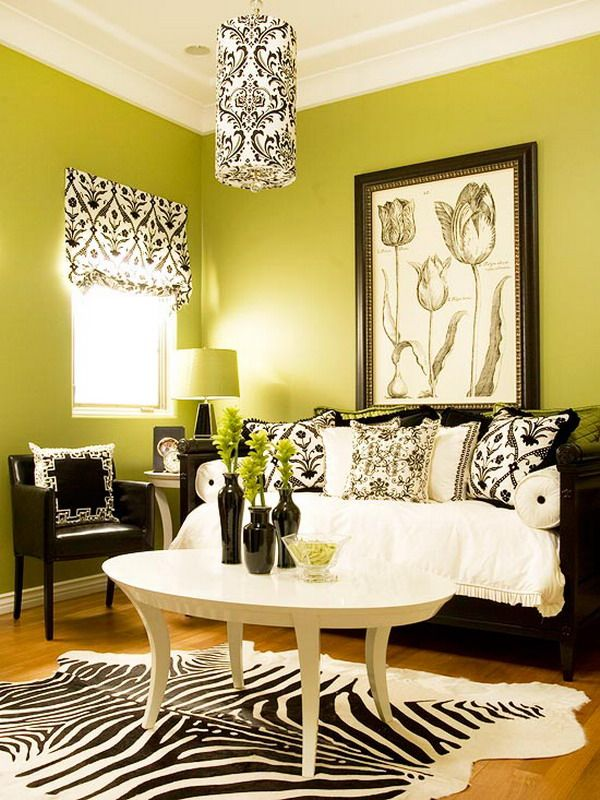 Green Living Room Design Featuring Black Sofa And Animal Print Rug Picture Part 96