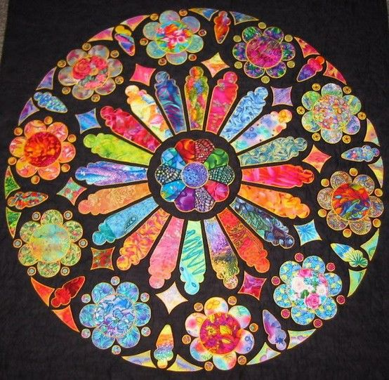 Rose Windows Medallion - What can I say?  This quilt took my breath away the first time I saw it.  I HAVE to make it!!!