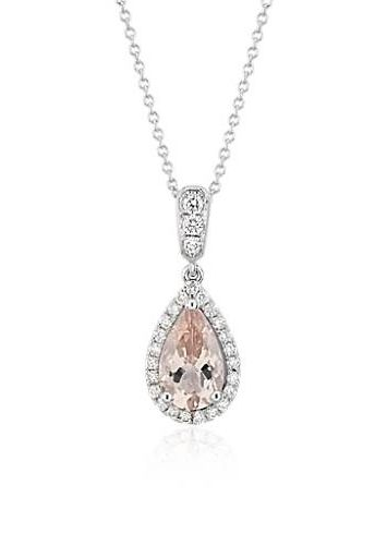 Brilliant diamonds form a glamorous halo around a pear-cut, peach-pink morganite gemstone, perfect for the romantic bride.