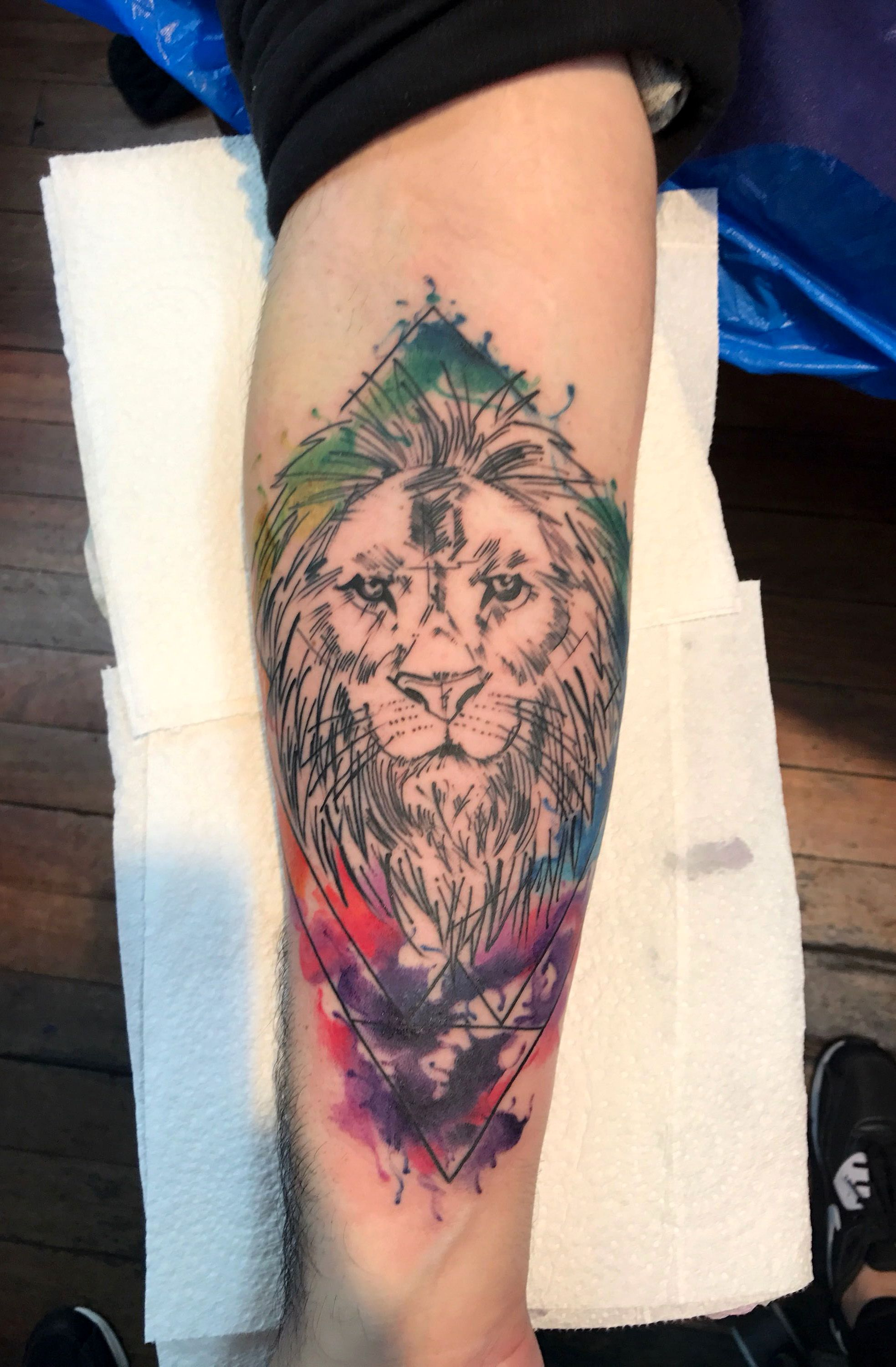 Watercolour Lion tattoo by Lauren Fox at Authentink in