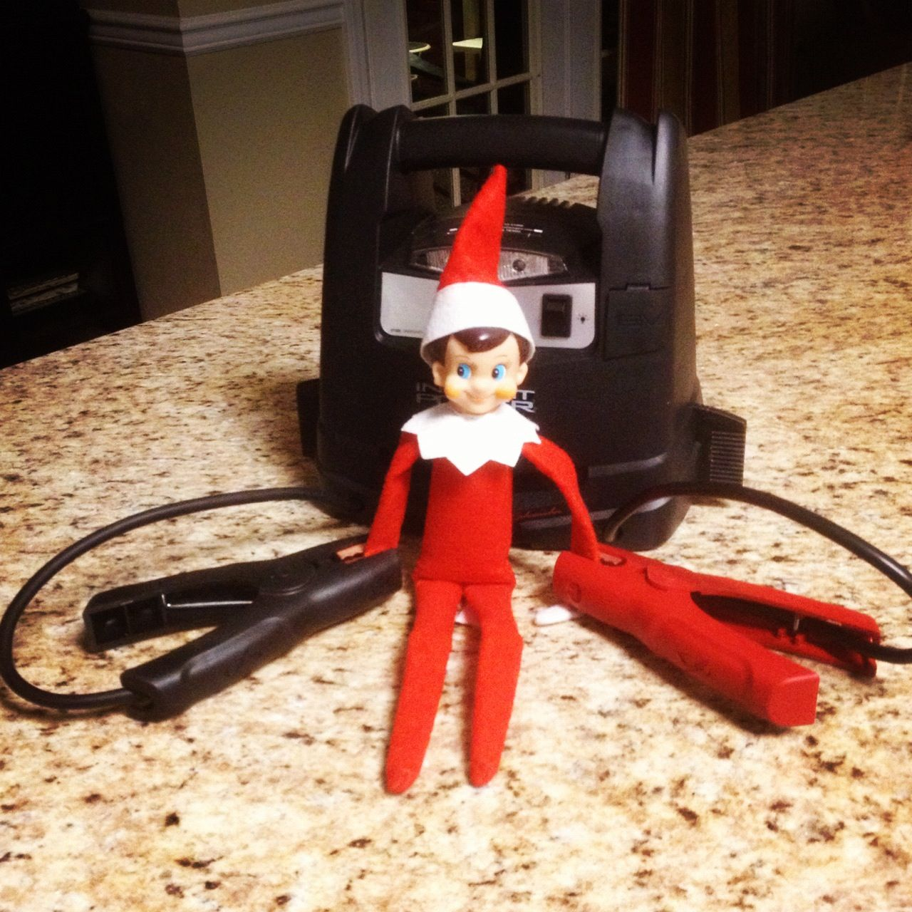 Elf on the Shelf charging up for Christmas!!!! ... Yikes!!!