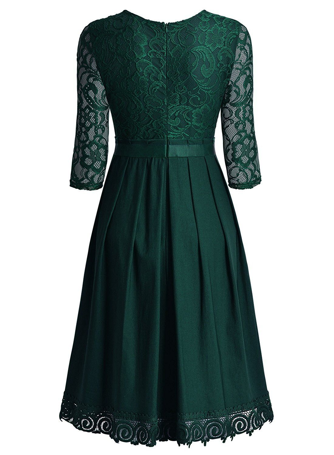 c841c65a8dab This simply elegant short dress features a 3/4 sleeve round neckline.  A-line retro style perfect for casual or any special occasion.