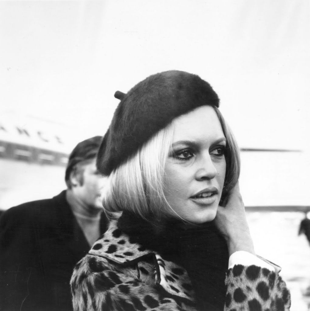 Bardot in leopard print jacket and black beret.