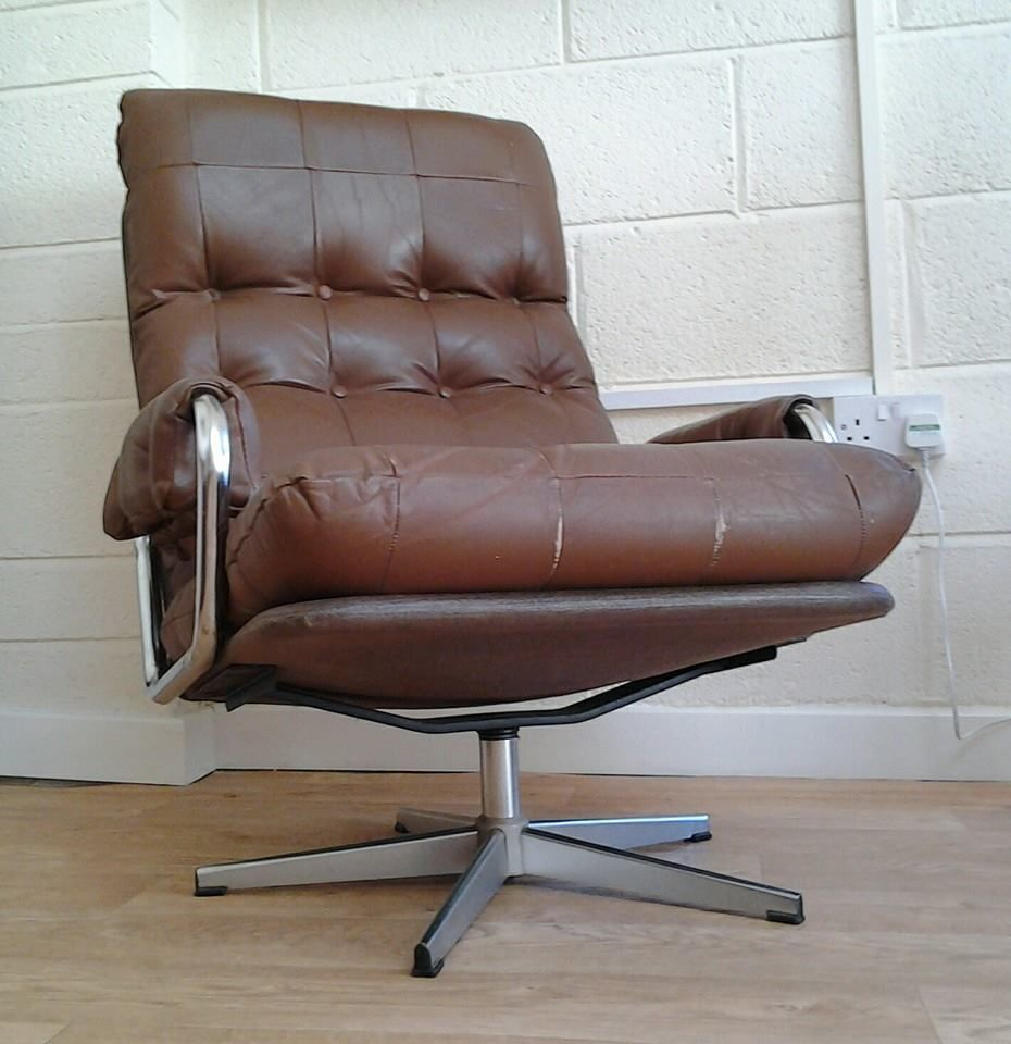 1970 s retro swivel armchair on a five pronged chromed
