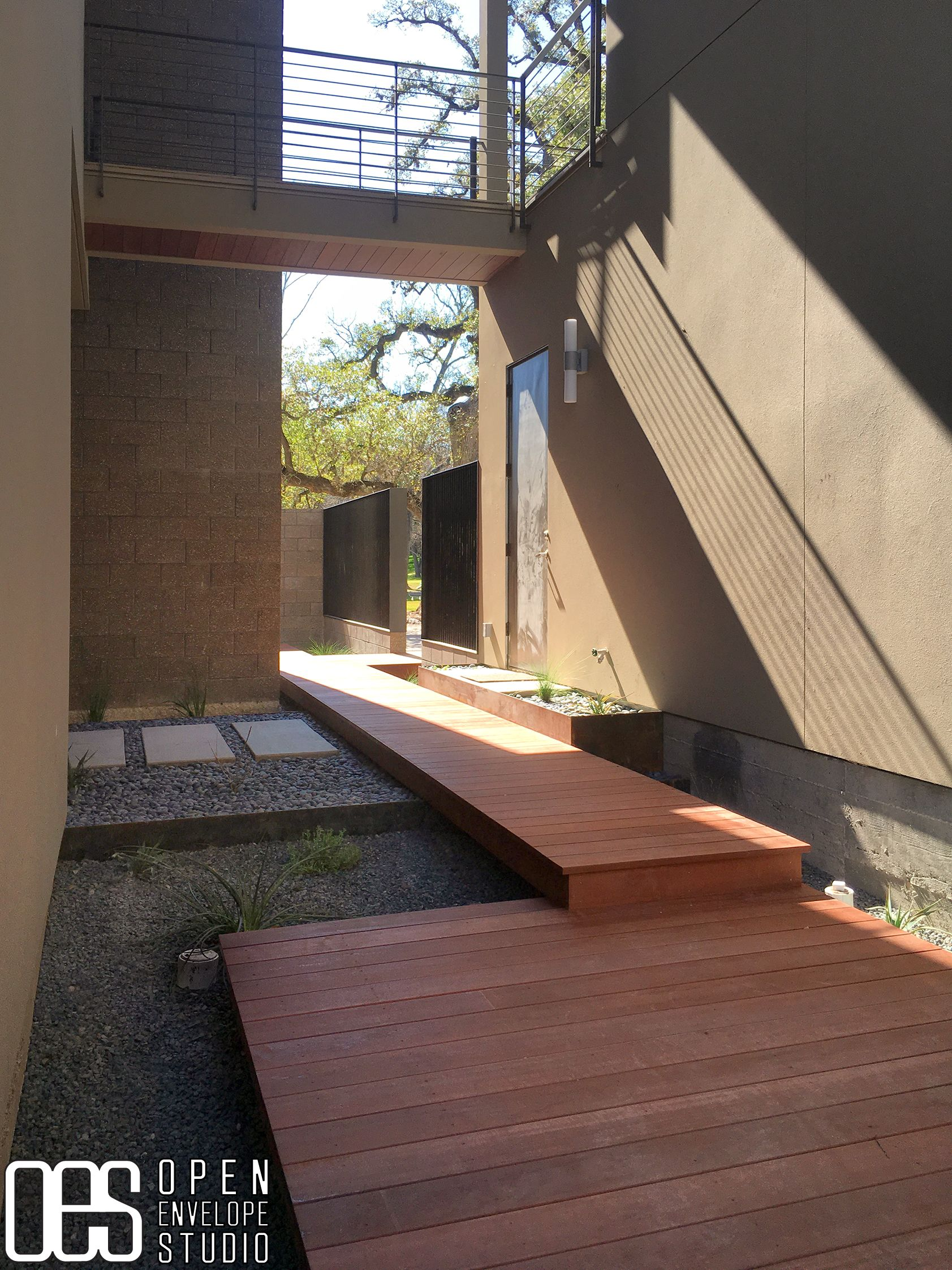 OES | Thomajan Residence: ipe hardwood boardwalk, concrete