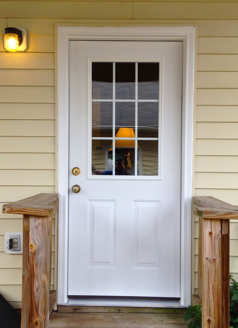 A simple white steel provia side entry door with two for Exterior storm doors