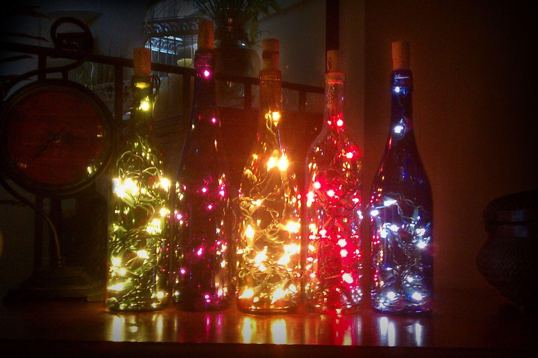 Decorations I Made With Different Color Wine Bottles And Christmas Lights Decoracion De Botellas Como Decorar Botellas Botellas De Vidrio