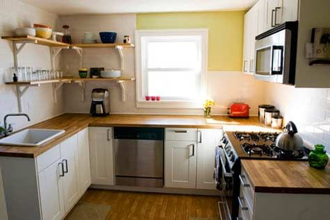 Imagen cocinas peque as 2014 cocina con muebles sencillos for Cocinas integrales modernas pequenas