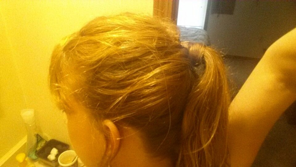 Messy wrapped ponytail side