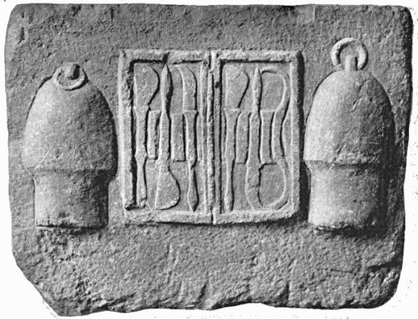 Votive tablet from the Temple of Asclepius at Athens, depicting a case of scalpels and cupping instruments.