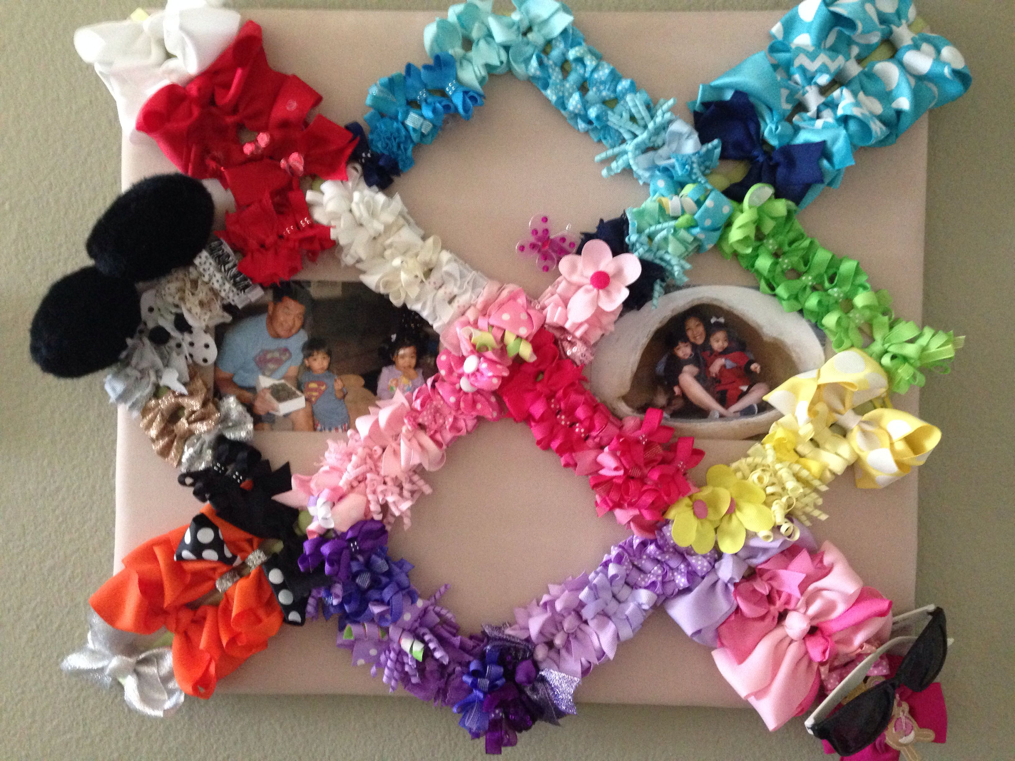 Displaying & organizing little girls hair bows! After trying so many different ways to keep my daughters bows organized I realized why not use one of my old photo ribbon holders! Works perfect & I can display photos as well!