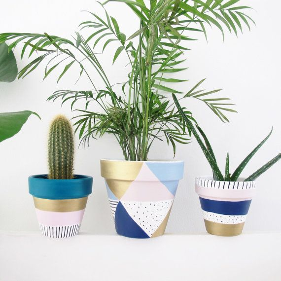 A Hand Painted Plant Pot In Pastels Stripes Spots And Gold Perfect For Spring Sealed Both Water Uv Protection Measures 13 5cm