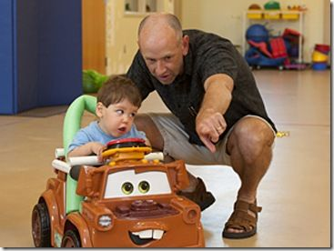 Here is a great site for inspiration on how to get little kids engaged in mobility even if they cant walk. The website shows how with the use of toys r us toys you can have kids moving all over.