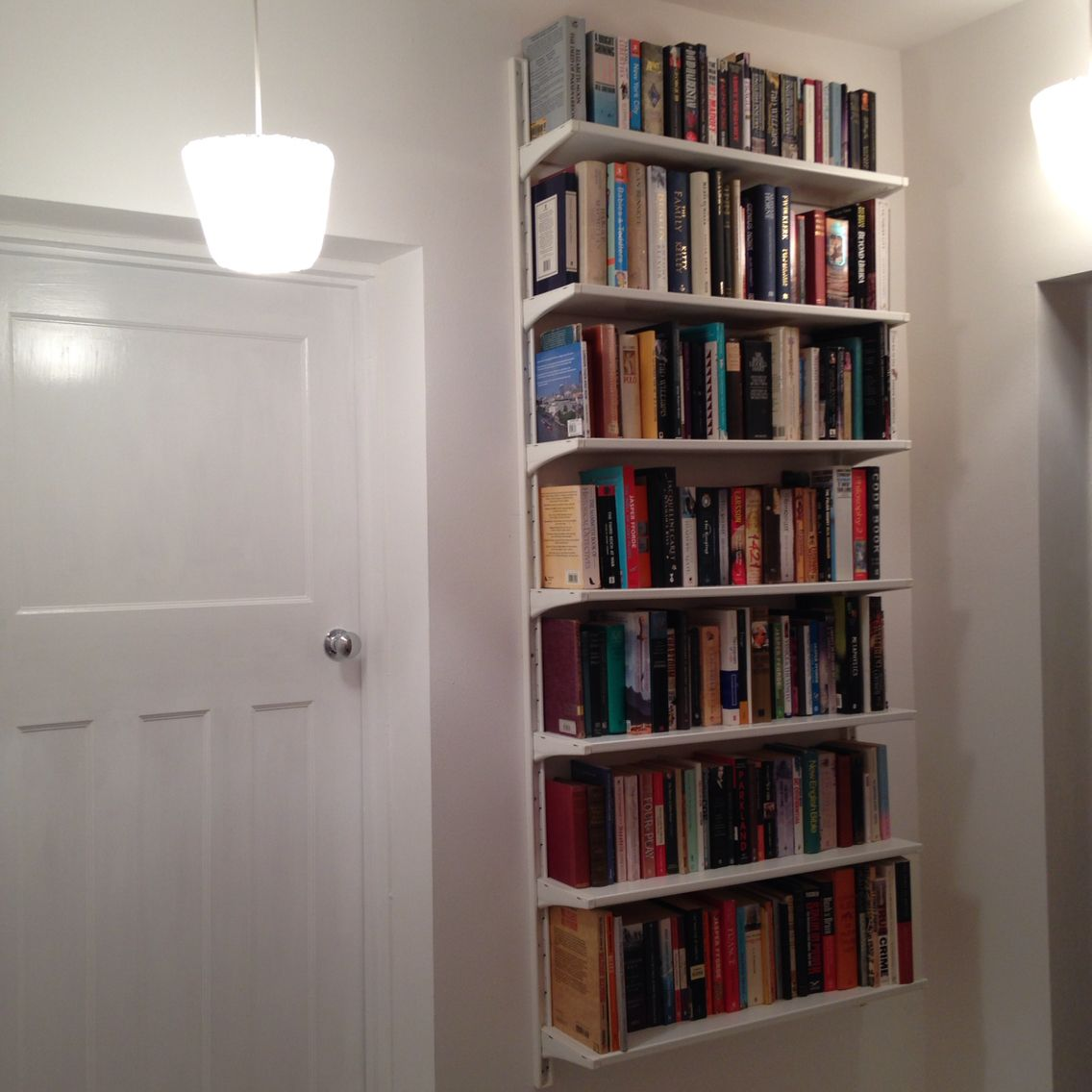 Ikea algot floating bookcases keeps floor space clear for - Estanteria algot ikea ...