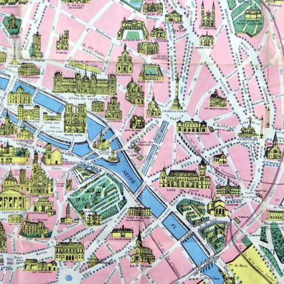 An antique folded poster sized map of Paris showing its famous