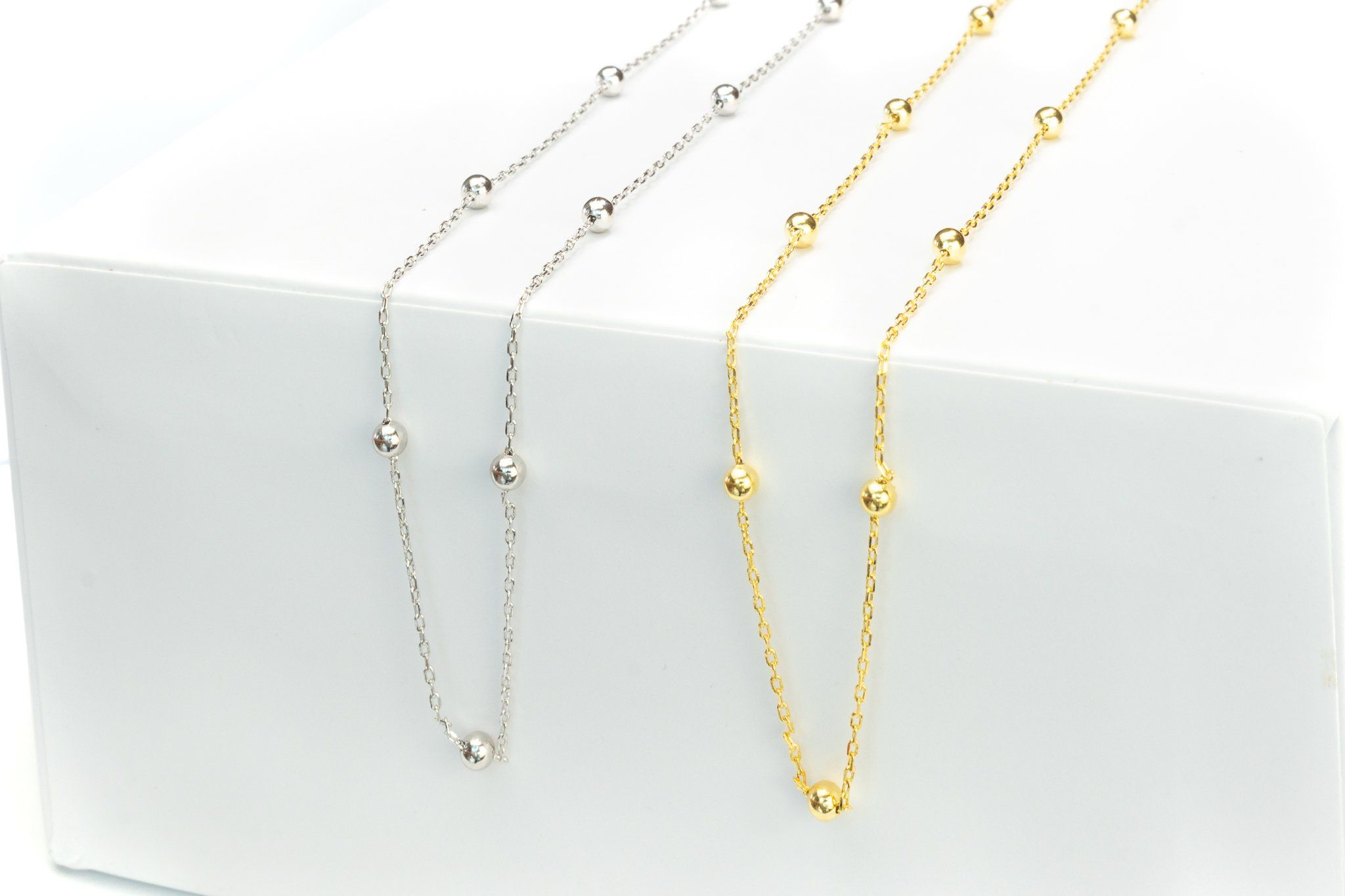 """This delicate choker is made of pure sterling silver, fastens with a simple clasp, and measures approximately 14 inches with a 2-inch extension (16"""" in total.) A truly versatile sterling silver necklace; while lightweight for comfortable all-day wear, the delicate pattern makes it memorable at the same time. Also available in 14K gold plated The unique chain-and-bead texture of Amore brings to mind little raindrops, making this lightweight and slender choker a lovely finishing touch to accent a"""