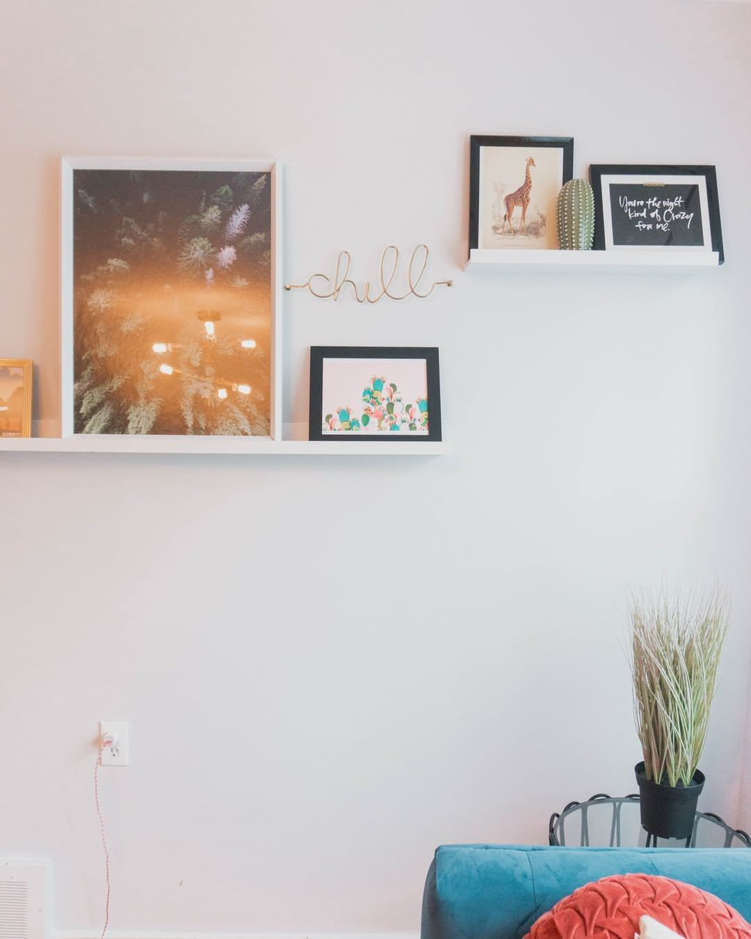 Picture ledges and a few art prints can make a huge difference! By using two picture ledges ($16.99 + $9.99 @IKEACanada ), you can easily swap out prints whenever the seasons change! You can also DIY that