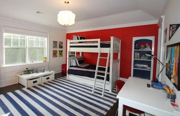 Red accent wall makes an interesting addition to this kids bedroom #kidsbedroom