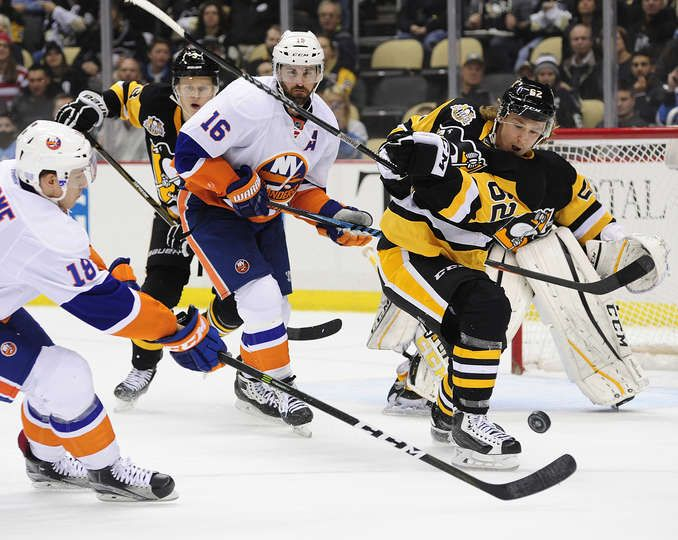 OCTOBER 27  Carl Hagelin  62 of the Pittsburgh Penguins clears the puck  against the New York Islanders 1bb85dd8a