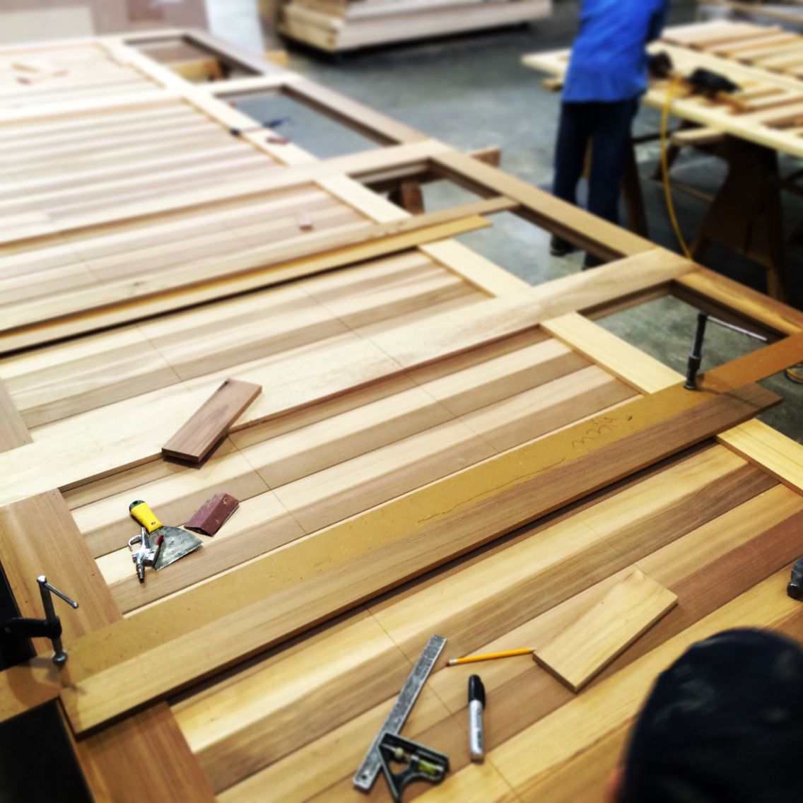 1 Piece At A Time Custom Cedar Garage Door From One Of Our Many Designs Modern Garage Doors Garage Doors Cedar Garage Door