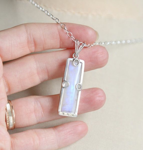 Northern lights collection, June birthstone, rainbow moonstone pendant with genuine diamonds, rectangle flashy stone sterling silver pendant.  The pendant is about 45mm long. The moonstone is about 30mm x 10mm. The moonstone is rainbow moonstone with a subtle light blue shine, which is why its called rainbow moonstone. There are 3 diamonds on the bottom of the pendant, each 1.2mm large.  Moonstone is the birthstone for the month of June. It stands for balance, good fortune, tender passion…