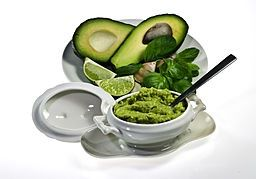Awesome Guacamole Dip with presentation of Raw Avocado in great serving dishes. Good for Paleo Diet! avocado-ers