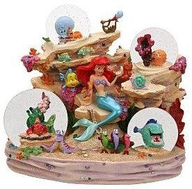 Photo courtesy of DisneyShopping.com Little Mermaid Description:  Ariel and her friends have a party under the sea.  Designed by Steve Thom...