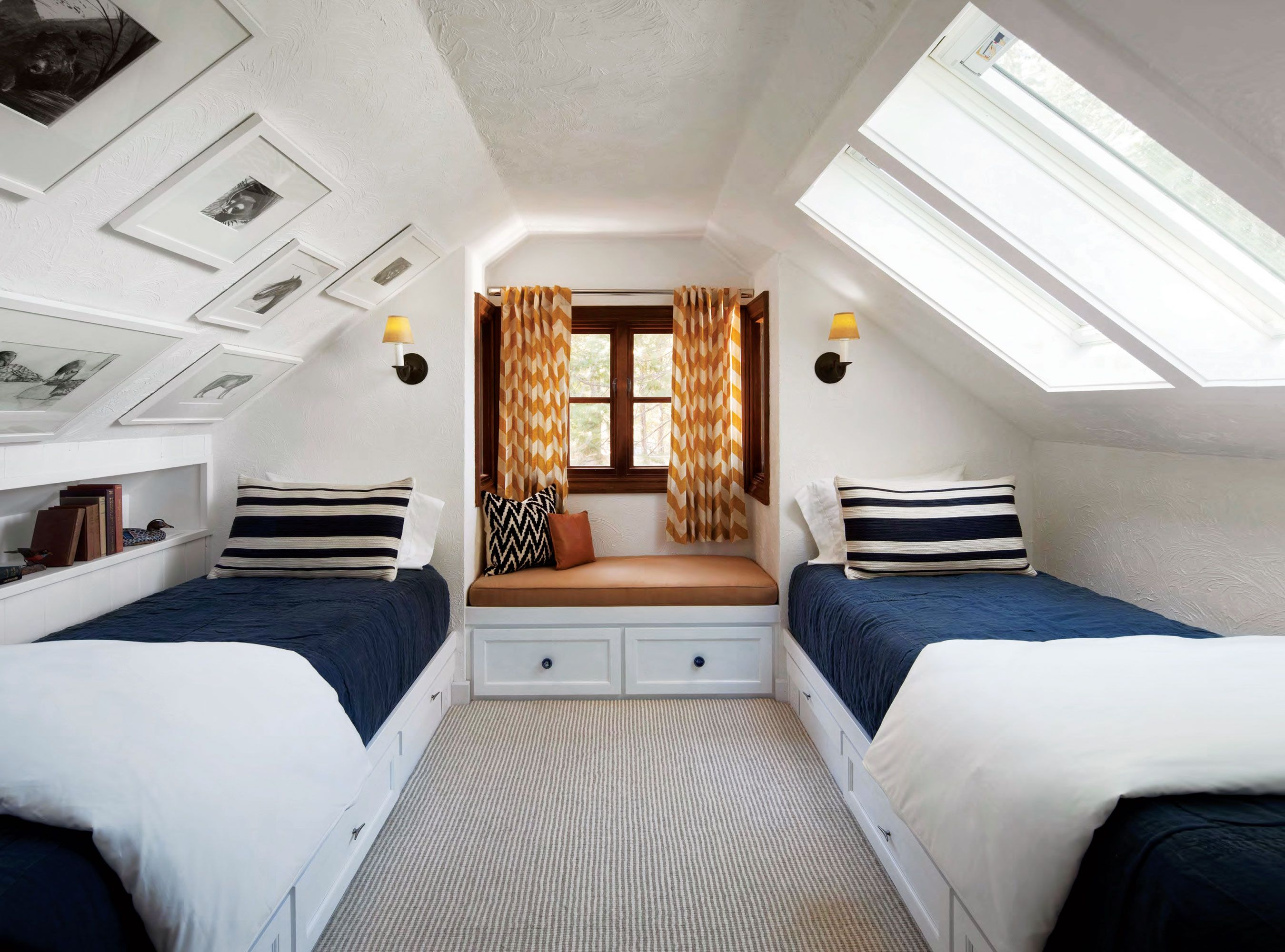 A pitched ceiling and builtin beds make a cozy guest nook