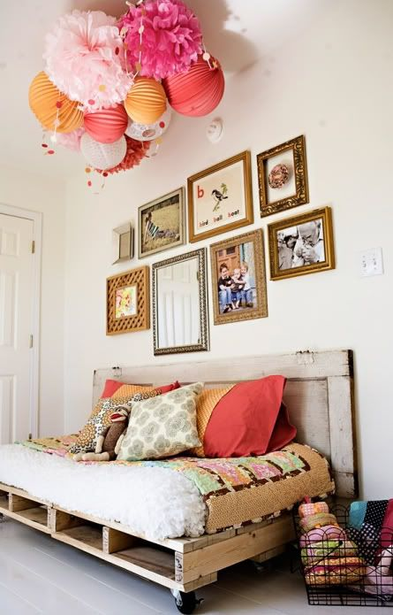 Something cozy about this eclectic space. matt's really into the palette furniture right now. this day bed is hot. love the way the mixed frames have a center line. not crazy about whatever's going on with the ceiling but i saw a similar conglomeration for a nursery that was cute.