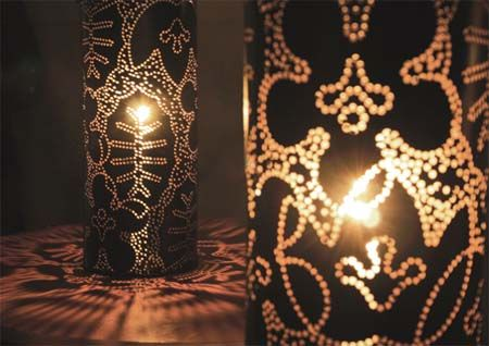 DIY - Need soft metal sheet, or handmade paper. Draw the pattern out (i.e. mark the holes) on the flat sheet and then use a sharp object to puncture the holes. Place the rounded lamp shade on an existing lamp base and you are done!