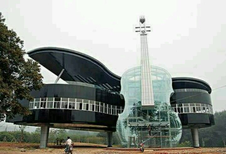 This house makes a statement but I would hate to have the job of cleaning windows   #unique house #guitar #piano #amazing house