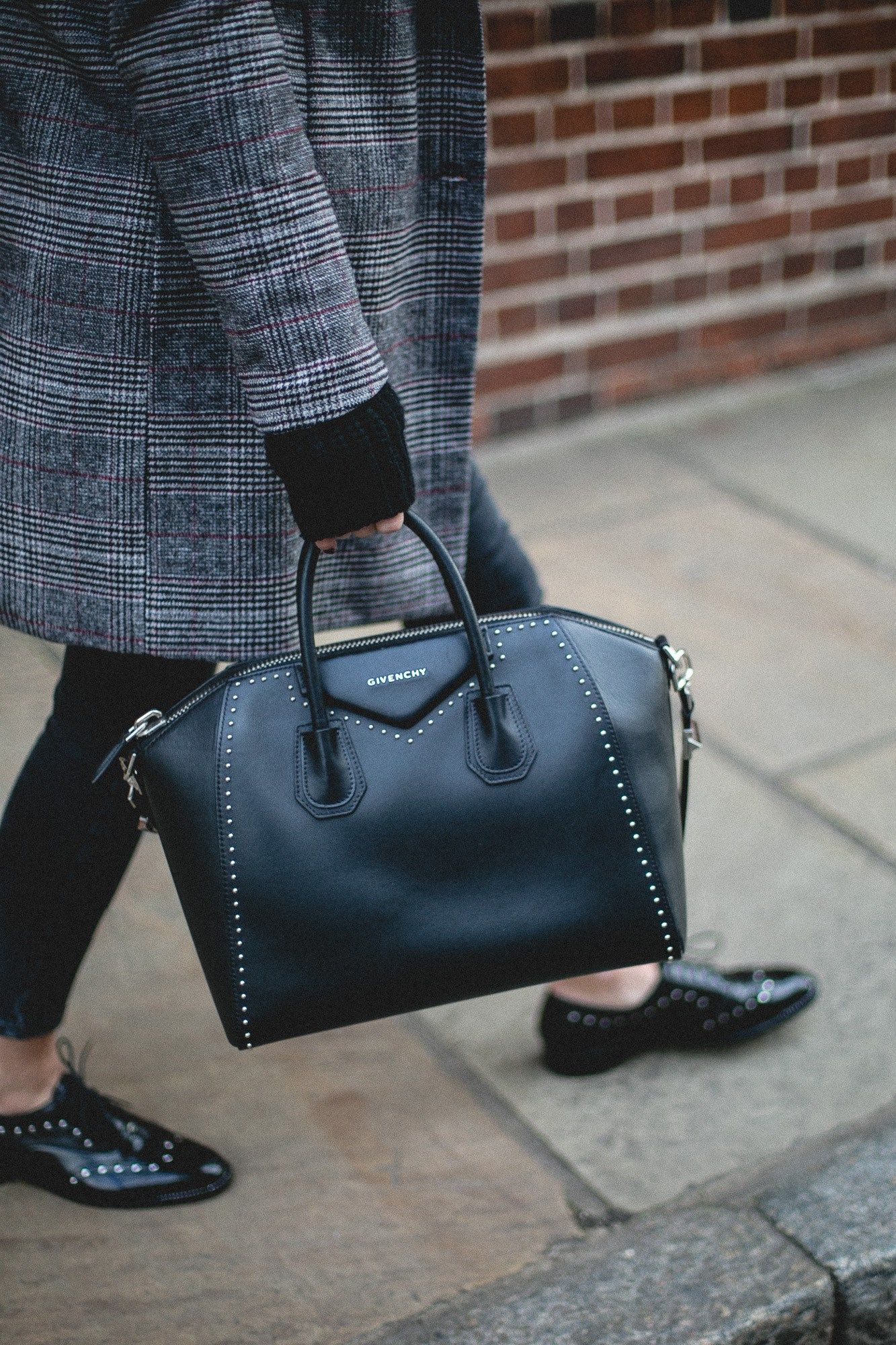 dcc269bd05976 Emma Hill wears Givenchy medium Antigona bag with studs