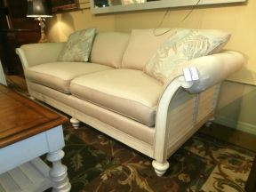 Price: $649.99 Item #: 137698 Bring relaxed island comfort into your home with this sofa from Havertys that comes upholstered in cream, a weathered off white wood base with shutters on the side, sits on turned bun style feet, and measures88W * 39D * 29H.