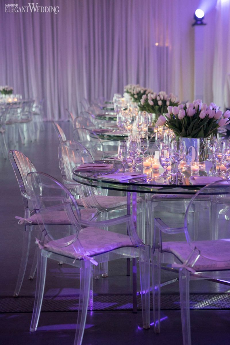Layered Glass Tables Filled With Tulips For A Wedding Reception A