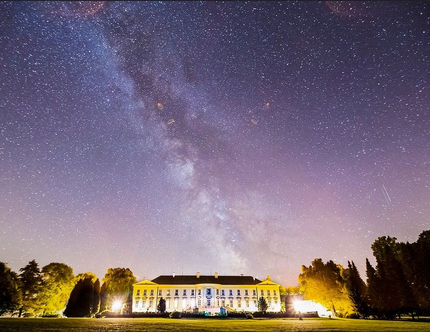 The Buquoy Chateau in Nove Hrady is a mansion with three hundred years of history. The castle was the residence of various members of the Buquoy aristocratic family. It's now operated by the Academy of Sciences of the Czech Republic as a research centre. This is a shot of the mention with the Milky Way above it during a cloudless night. ..