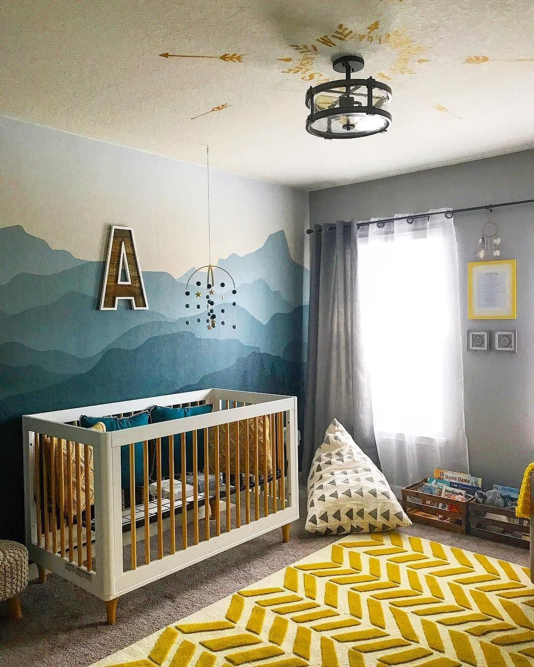 mustard yellow and teal blue nursery with mountain