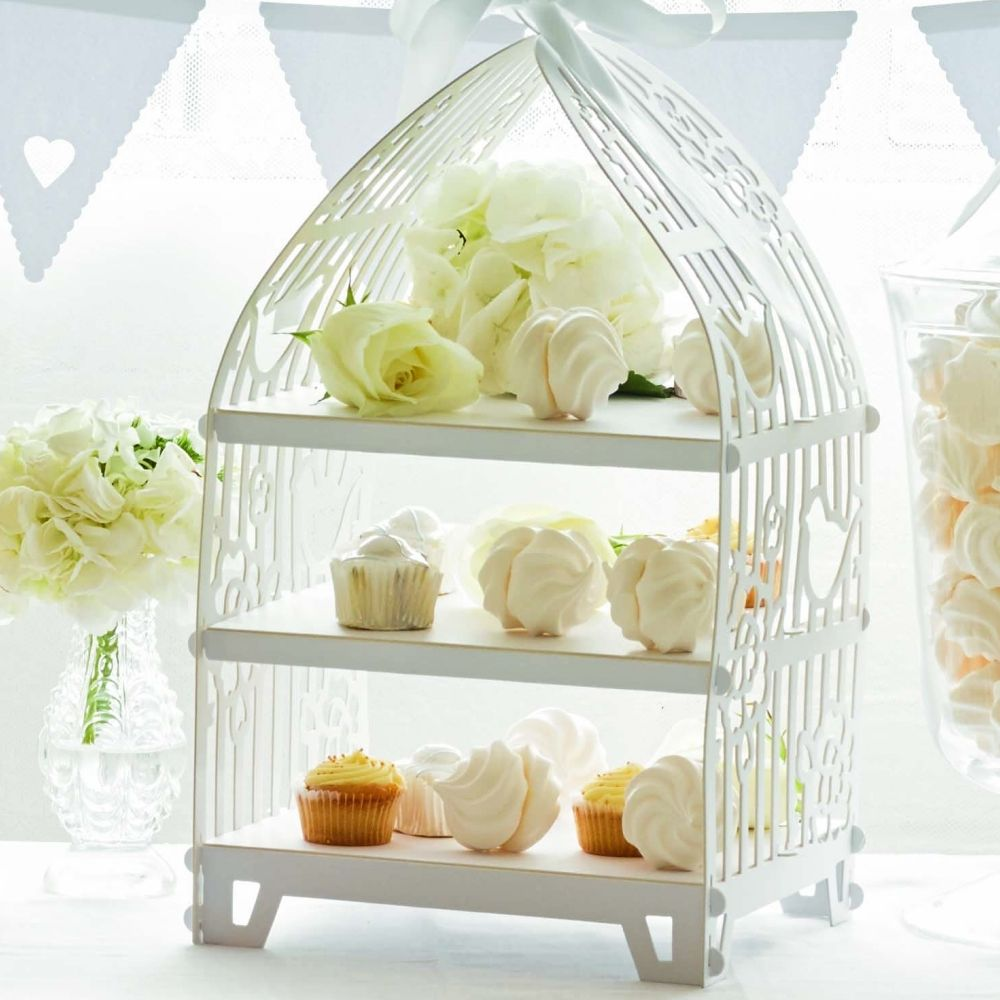 Delicate white birdcage style cardboard cake stand for