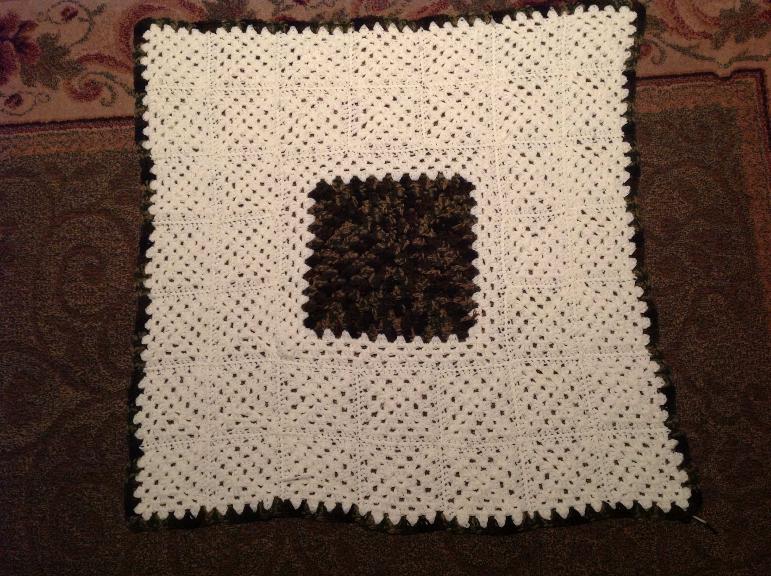 My 1st baby blanket using granny squares