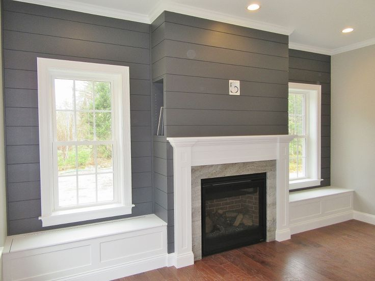 Cozy living area with custom built-ins. #fireplace #shiplap #custombuiltins #bui images