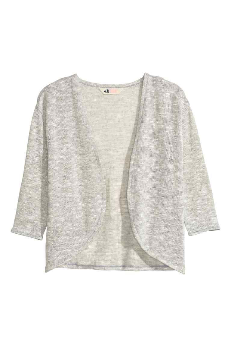 Cardigan in maglia fine: Morbido cardigan in maglia fine mélange. Linea arrotondata in basso e senza bottoni.