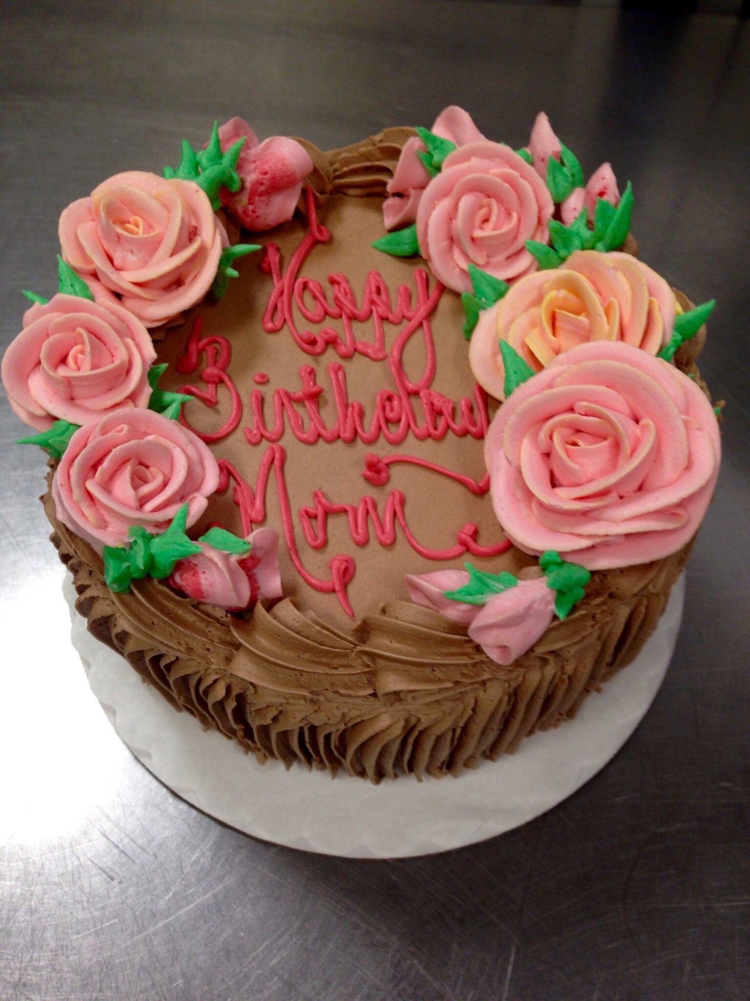 A little cake with pink coral color roses just for mom