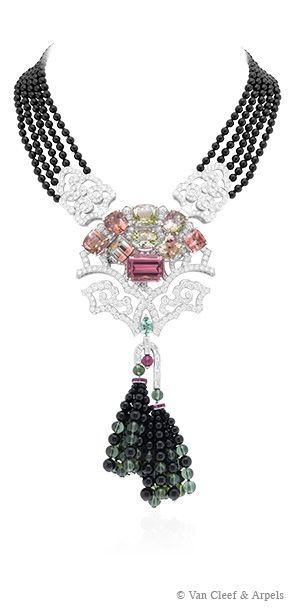 Arbre de Vie necklace, Palais de la chance collection White Gold, onyx beads, diamonds, tourmalines, 8 two-tone tourmalines Frequent symbol for numerous cultures, the Arbre de Vie necklace from Palais de la chance collection embodies the strength of life and its origins, the importance of roots and the development of life. The two-tone tourmalines represent the branches of the Tree of Life. The roots of the tree are adorned with two cascading tassels of onyx beads.