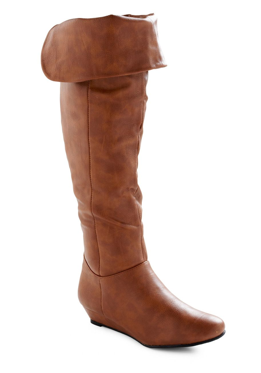 After a family feast, you and your loved ones gather around the fireplace. Finding a place on the rug, you hug your knees and show off your toasty brown, wedge boots. Made of soft vegan faux leather, these fold-over, zip-up, knee-high boots keep you feeling warm and looking cool despite the wintry weather.
