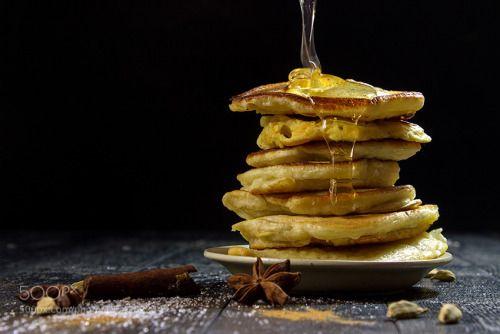 pancakes with pouring honey on a black background by Kot_v_samolete  IFTTT 500px pancake background banana black blueberry jam breakfast butter cinnamon closeup delici
